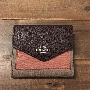 Coach color lock tri-fold wallet
